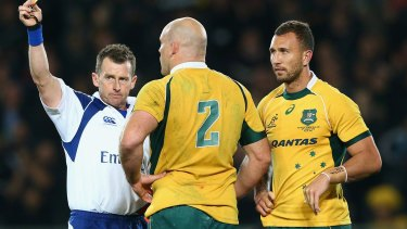 Nigel Owens shows Quade Cooper a yellow card during the Bledisloe Cup fixture in August.