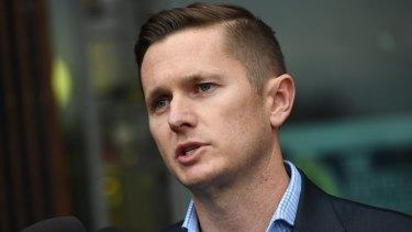 AWU national secretary Daniel Walton speaks to the media following the raids.