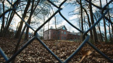 A fence encloses a, now closed, Russian compound in the village of Upper Brookville on Long Island.