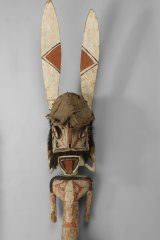 Wooden malanggan carving depicting a male figure from the Bismark Archipelago, Papua New Guinea.