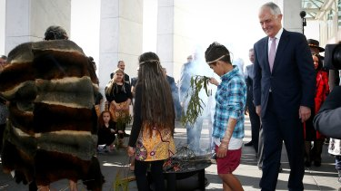 Prime Minister Malcolm Turnbull during the smoking ceremony at the welcome to country ceremony on the forecourt to mark the opening of the 45th Parliament, at Parliament House in Canberra.