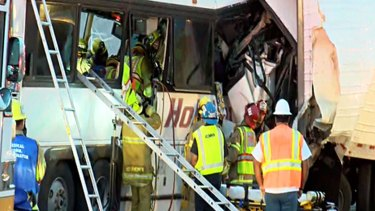 The scene of crash between a tour bus and a semi-truck near Palm Springs, in California's Mojave Desert.