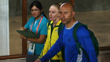 Sally Pearson (centre) and coach Eric Hollingsworth (right) during the 2010 Commonwealth Games.