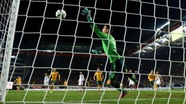 Germany goalkeeper Zieler cannot stop Jedinak's screamer.