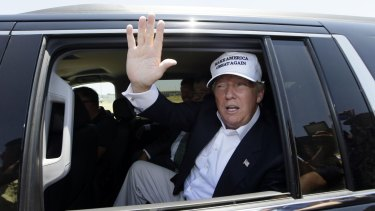 Republican presidential hopeful Donald Trump waves from his vehicle during a tour of the World Trade International Bridge at  the US-Mexico border in Laredo, Texas.