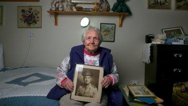 World War 1 widow Mrs Doris Johnson, 91, with a photo of her late husband Neville Johnson.