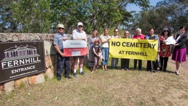 Tanya Davies, the local member for Mulgoa (pictured far right), met with residents at the entrance to Fernhill estate on Wednesday to receive a petition containing over 1000 signatures opposing the proposal to convert the historic estate into a cemetery.