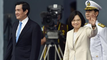 Taiwan's Tsai Ing-wen, right, waves beside her predecessor President Ma Ying-jeou on Friday.