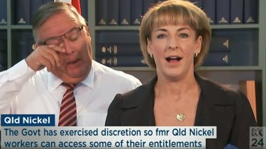 Herbet MP Ewen Jones breaks down during a press conference with Employment Minister Michaelia Cash.