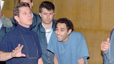 Yigal Amir smiles in a Tel Aviv court on  December 6, 1995, during a hearing in which murder charges were brought against him.