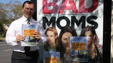Member for Moreton Graham Perrett with the offending poster for Bad Moms.