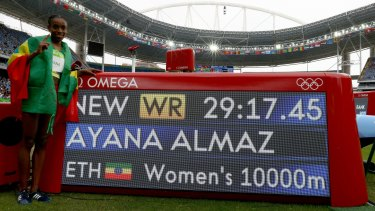 On top of the world: Almaz Ayana celebrates her world record.