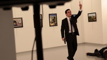 A man with a gun shouts inside the Ankara gallery as Russian ambassador to Turkey Andrei Karlov lies on the ground.