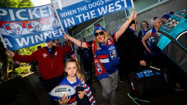 Bulldogs supporter Nicole Moore arrives at Whitten Oval last weekend after a bus trip to Sydney to watch the Doggies' preliminary final defeat of GWS,