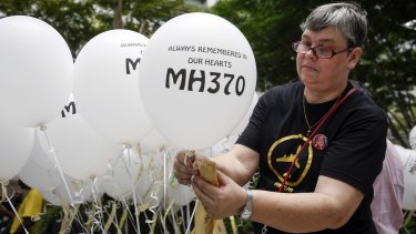 Jacquita Gomes, wife of Patrick Gomes, the in-flight supervisor on MH370, prepares balloons with names of those on board during a remembrance event in Kuala Lumpur last week.
