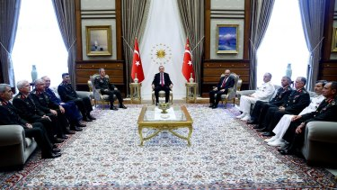 President Recep Tayyip Erdogan holds court with military chiefs during a meeting in Ankara on Friday.