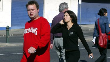 The late-Carl Williams arriving at a gangland murder in Carlton, with his then-wife Roberta Williams, in 2004.