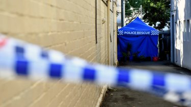 Police continue to search a home in Surry Hills, Sydney.