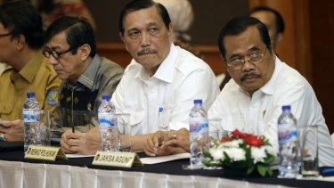 Indonesian Minister for Legal Affairs Luhut Panjaitan, centre, with Attorney General H.M. Prasetyo, right, and Justice Minister Yasonna Laoly, second left, last month.