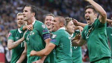 Ireland players surround John O'Shea after the centurion scored the equaliser.