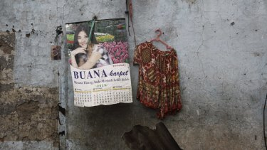 A photo, a calendar and a blouse: possessions visible as homes and workplaces were demolished in Kalijodo.
