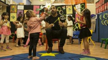 Adam Goodes attends graduation day at Poet's Corner preschool in Sydney's Redfern.