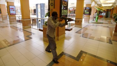 September 2013: an armed policeman searches for gunmen during the attack at  the Westgate shopping mall.