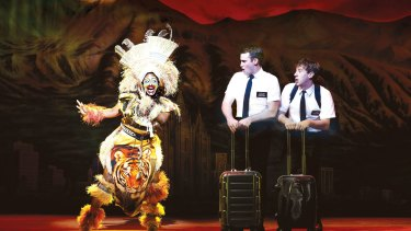 Phyre Hawkins as Mrs. Brown, Ryan Bondy as Elder Price and AJ Holmes as Elder Cunningham in <i>The Book of Mormon</i> at Melbourne's Princess Theatre.
