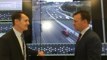 Lord Mayor Graham Quirk and Transurban's Wes Ballantine announce their agreement for the toll road operator to upgrade and run the Inner City Bypass.