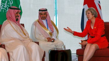 Britain's Prime Minister Theresa May and Saudi Arabia's Deputy Crown Prince Mohammed bin Salman, left, hold a bilateral meeting before the start of the G20 summit in Hangzhou, China.