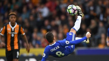 Near certain acquisition: Oscar attempts an overhead kick against Hull City for Chelsea.