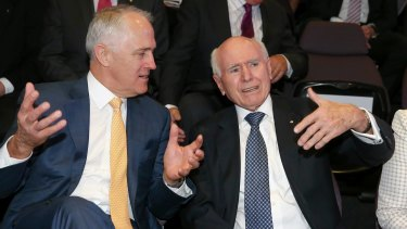 Mutual admiration: Mr Turnbull with former prime minister John Howard during the launch of the John Howard Walk of Wonder at science and technology centre Questacon in Canberra on Tuesday.