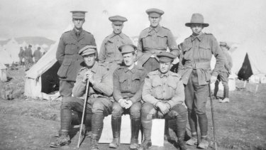 Putting on a brace face: diggers at Fromelles in France frock up for a photo opportunity.