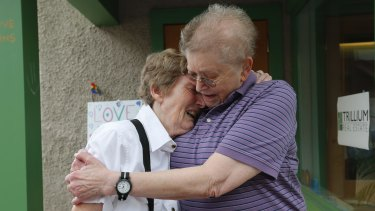 Marge Eide and Ann Sorrell, a couple for 43 years, embrace before exchanging vows in Ann Arbor, Michigan.