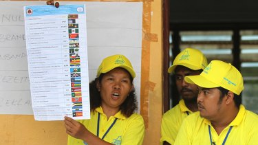 An electoral worker shows a ballot paper in Dili, East Timor, on Saturday.
