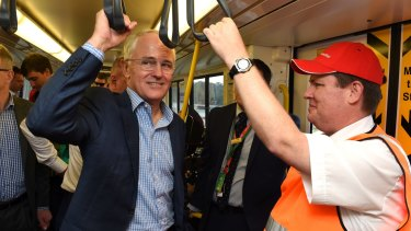 Prime Minister Malcolm Turnbull rides the new Redcliffe railway line in Brisbane,