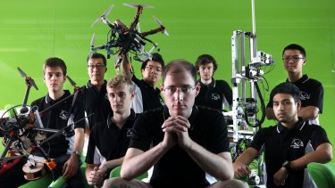 Mechatronics engineer Mark Whitty (front centre) with the UNSW team off to Abu Dhabi to compete for $US5 million in the world's richest robotics competition.