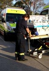 NETS ambulence driver Bruce Dalziell unloads a neonatal life-support system.