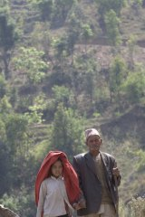 Jokh and his granddaughter Kamala on their way to an eye clinic to get his cataract treated.