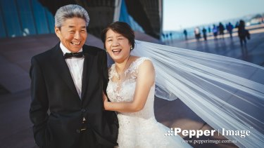 They didn't wear a tux or bridal gown when they married in 1974, so to celebrate their 42nd wedding anniversary Mr Zhao and Mrs Lv did just that.