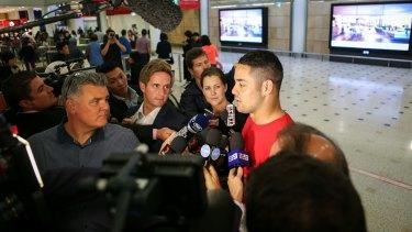 Back in town: Jarryd Hayne speaks to the media at Sydney Airport.