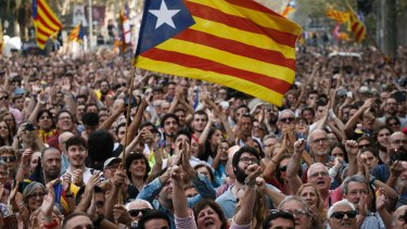 Protesters react as news comes through of the Catalan parliament's declaration of independence on Friday.
