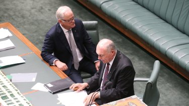 Leaving: Trade Minister Andrew Robb and Deputy Prime Minister Warren Truss at Parliament House on Thursday.