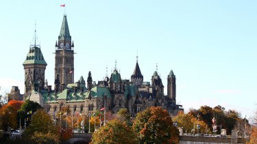 Scene of an attack: The Canadian flag flies over Parliament Hill in Ottawa.