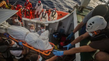 Aid workers of Proactiva Open Arms recover dead bodies of sub-Saharan migrants inside a rubber boat in the Mediterranean Sea.