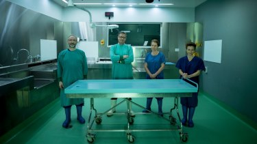 Associate Professor David Ranson, Associate Professor Richard Bassed, Dr Jodie Leditschke and Dr Linda Iles in the mortuary.