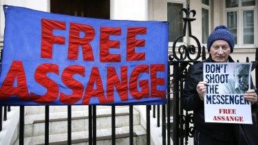 A demonstrator outside Ecuador's London embassy.