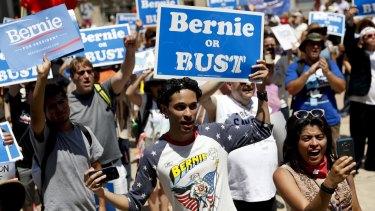 Supporters of Senator Bernie Sanders listens during a rally near City Hall.