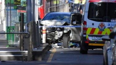 The scene at the corner of Flinders and Elizabeth Street.