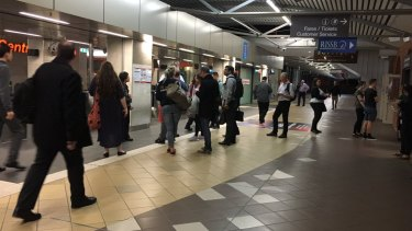 QR staff were answering questions for confused commuters at Central train station